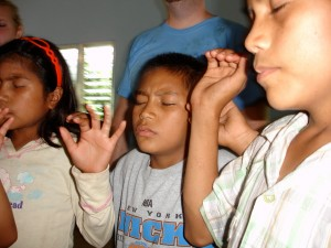 Honduran children worshipping