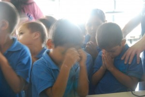 Honduran boys praying to receive salvation